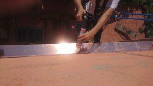 Montaggio pensilina in rame in via delle tovaglie a Bologna 1